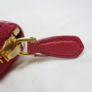 財布のファスナー持ち手のコバが剥げ