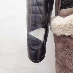 皮コートの袖部分を引っ掛けて皮革が裂け